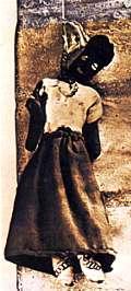 Una muñeca utilizada en la magia negra haitiana. Representa a la persona a quien el hechicero quiere dañar, por maldad personal o porque un enemigo de la víctima le ha pagado para que lo haga.